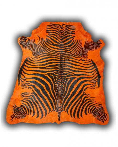 Alfombra de piel de toro con diseño cebra color naranja